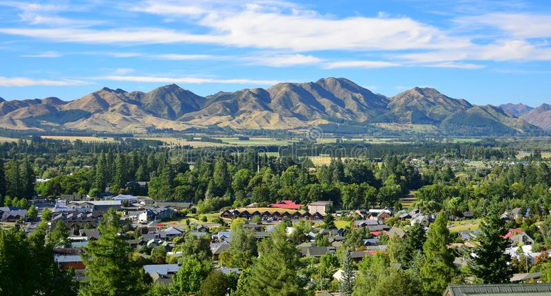 The small town Hanmer Springs in New Zealand with mountains in the background. Canterbury, South Island. The small town Hanmer Springs with mountains in the royalty free stock photo