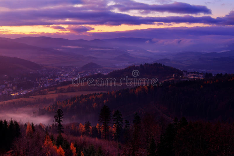 Small town Jesenik with spa resort in the mountain forest. Czech early morning landscape with beautiful sunrise with pink and viol stock photo