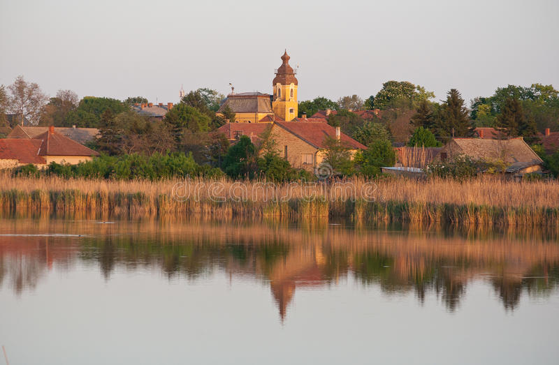Small town on the lake. With the Church in southest of Europe named Backo Gradiste,Serbia... lake is full of duck, heron, stork, fish stock images