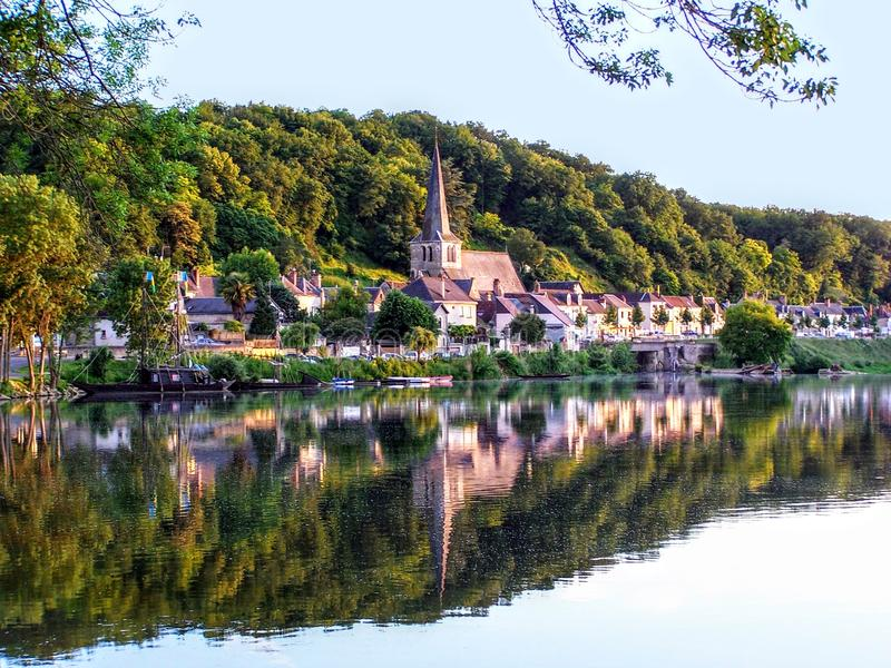 Small town on the Loire river with old houses, boats and the church in France. Europe royalty free stock image