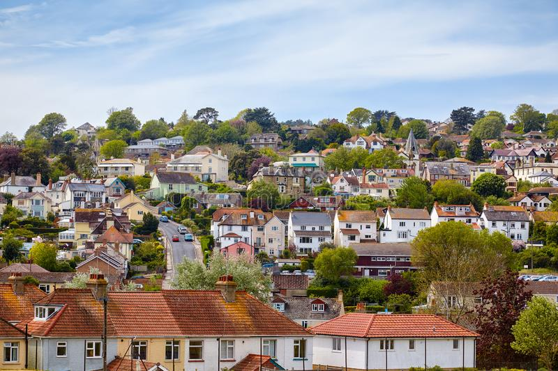 The small town of Lyme Regis on the slope of the hill. West Dorset. England. The view of the residential houses of the small town of Lyme Regis on the slope of stock photography