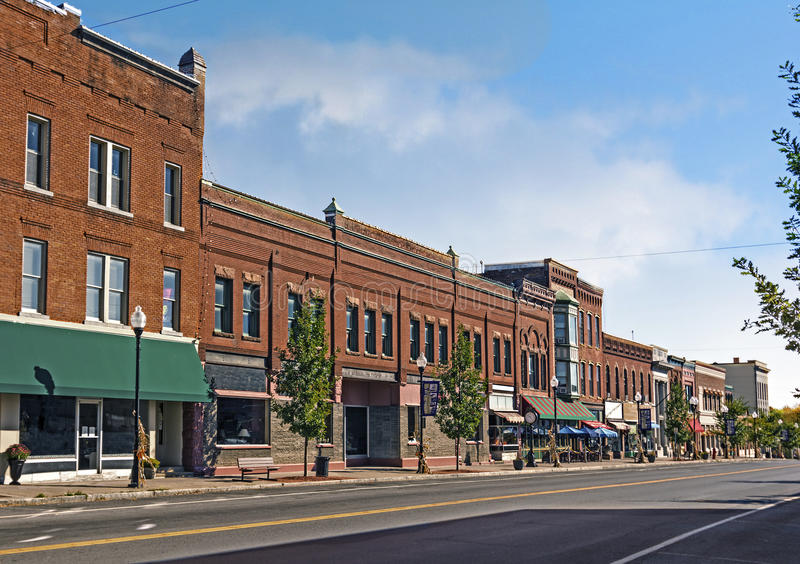 Small Town Main Street. A photo of a typical small town main street in the United States of America. Features old brick buildings with specialty shops and royalty free stock photos