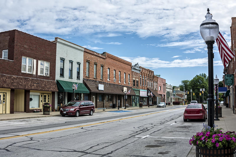 Small Town Main Street. A photo of a typical small town main street in the United States of America. Features old brick buildings with specialty shops and stock image