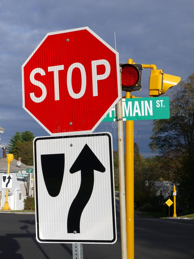 Small town: main street road signs. Main street road signs and stop light, late afternoon in Petersham, Massachusetts stock photos