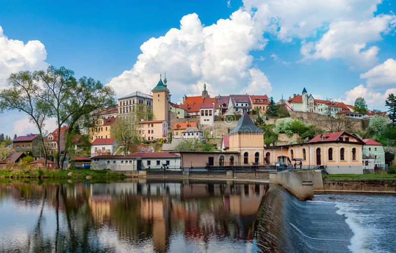 Small town panorama view with historic buildings and water weir. Small town in central Europe, panorama view with historical old town centre, river, water weir stock photo