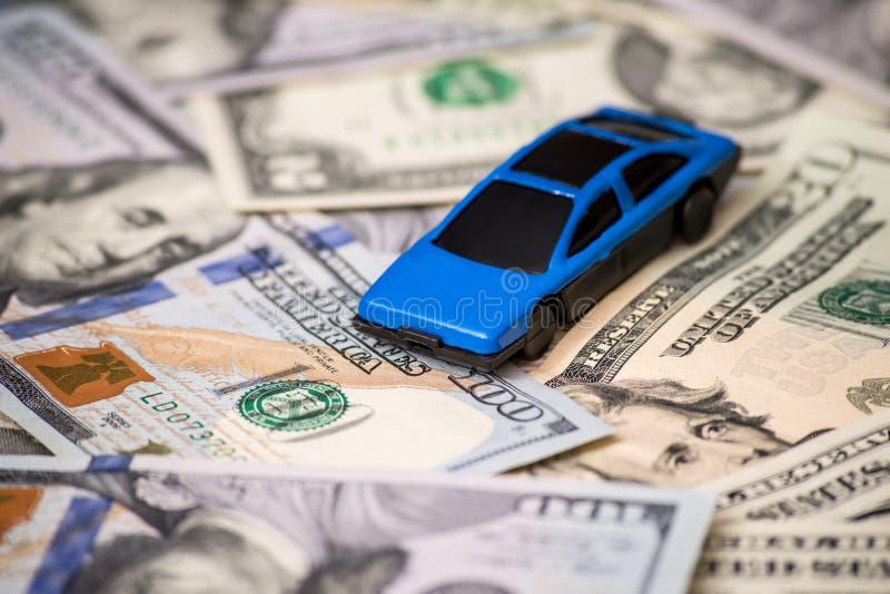 Small toy car on usa dollar. Banknotes stock photos