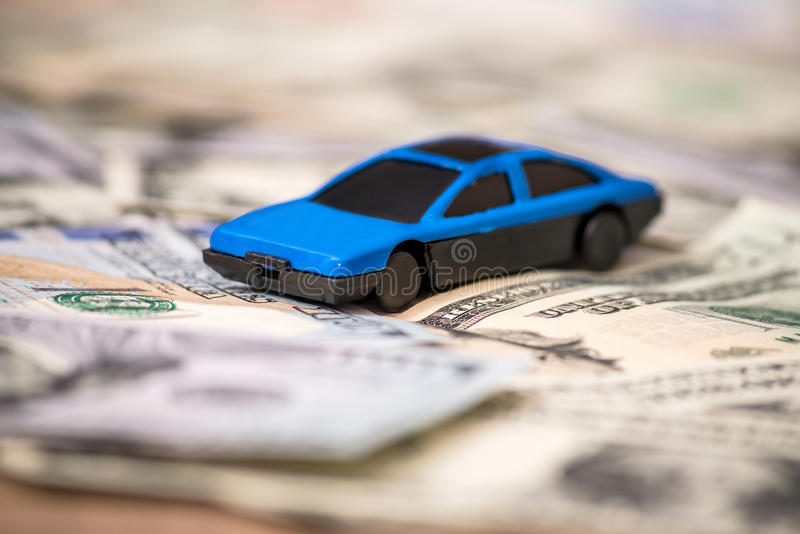 Small toy car on usa dollar. Banknotes royalty free stock image