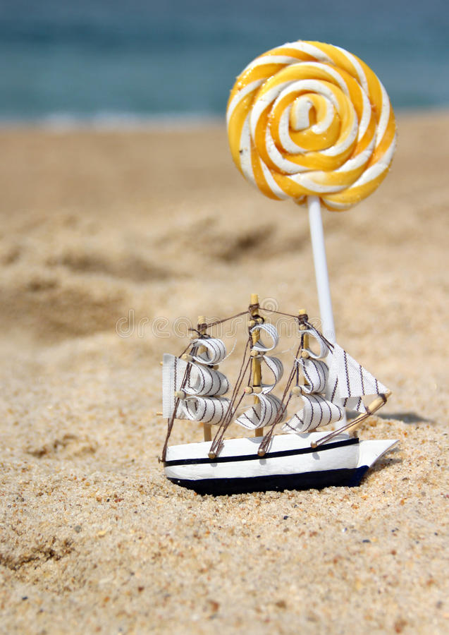 Download Small Toy Sailing Ship On The Beach Royalty Free Stock Photography - Image: 26302427