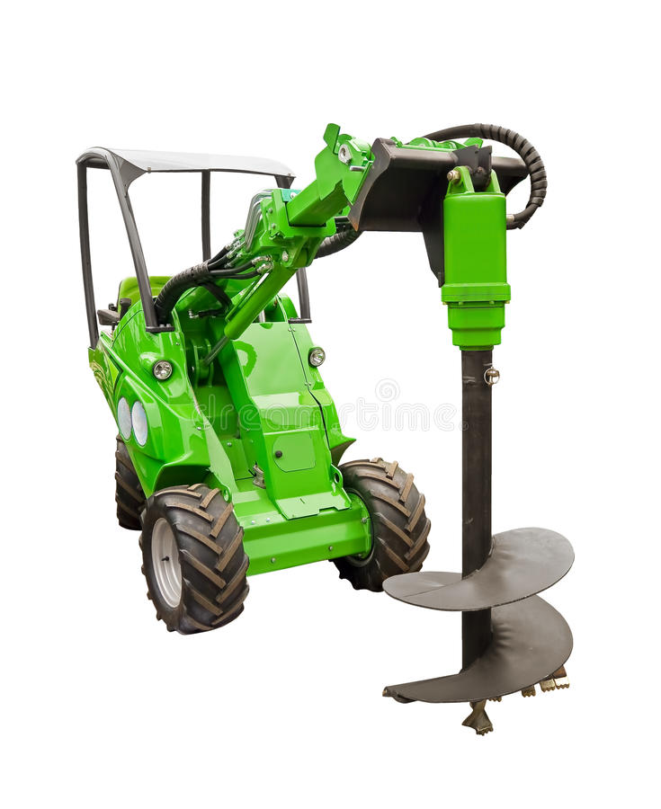 Small tractor with a large drill bit stock photos