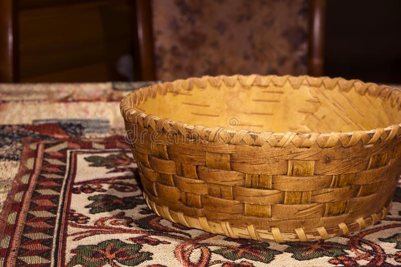 Small traditional birch bark flat basket for products stock photos