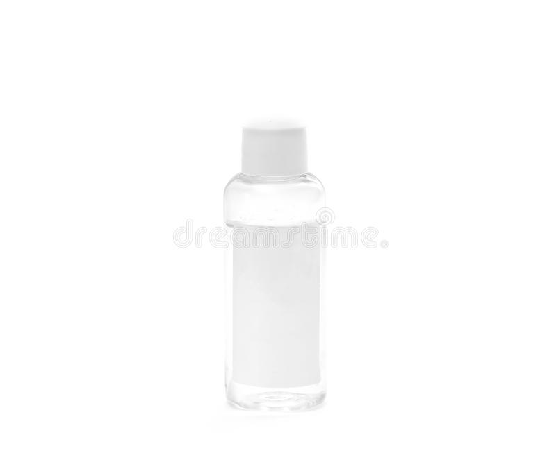 Small transparent plastic bottle with white cap and white blank label isolated on white background. place for text. Small transparent plastic bottle with white stock photos