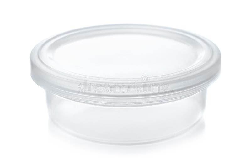 Small transparent round plastic container stock images