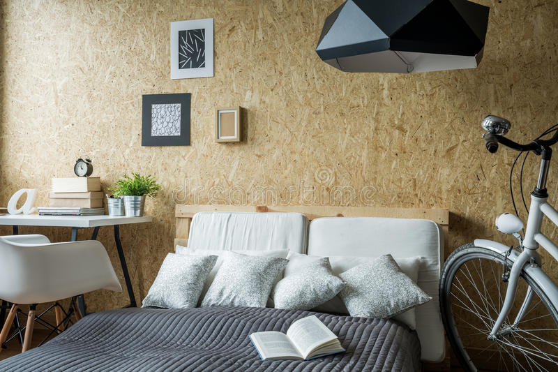 Small trendy bedroom stock photography