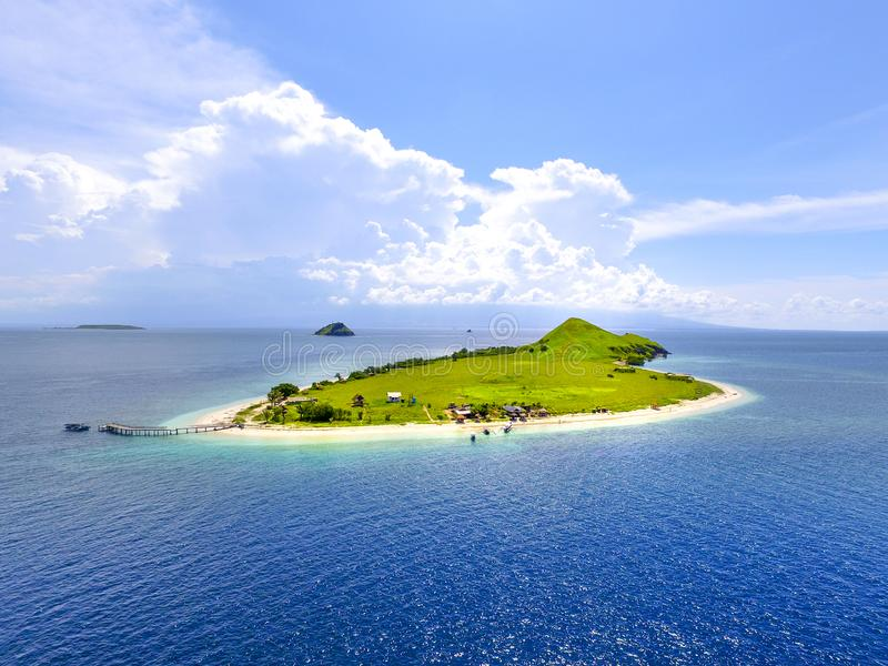 Small tropical island with white green savannah and sandy beach. Beautiful Kenawa island view from above. Nature of the Indonesia stock image