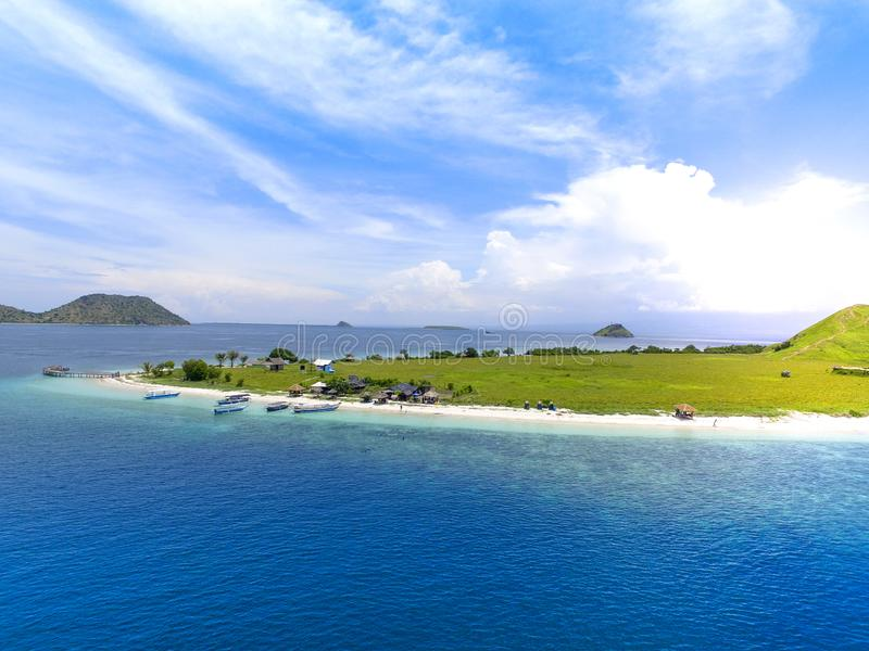 Small tropical island with white green savannah and sandy beach. Beautiful Kenawa island view from above. Nature of the Indonesia stock images