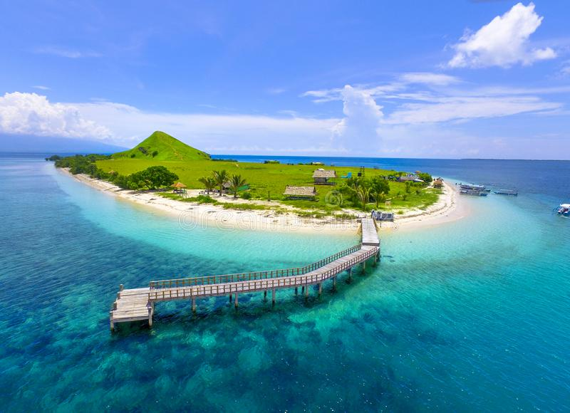 Small tropical island with white green savannah and sandy beach. Beautiful Kenawa island view from above. Nature of the Indonesia stock photos