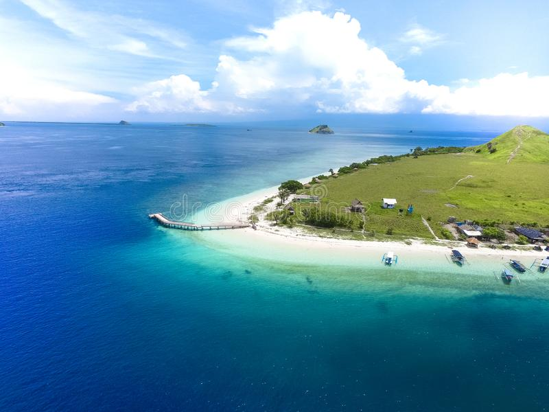 Small tropical island with white green savannah and sandy beach. Beautiful Kenawa island view from above. Nature of the Indonesia royalty free stock photo