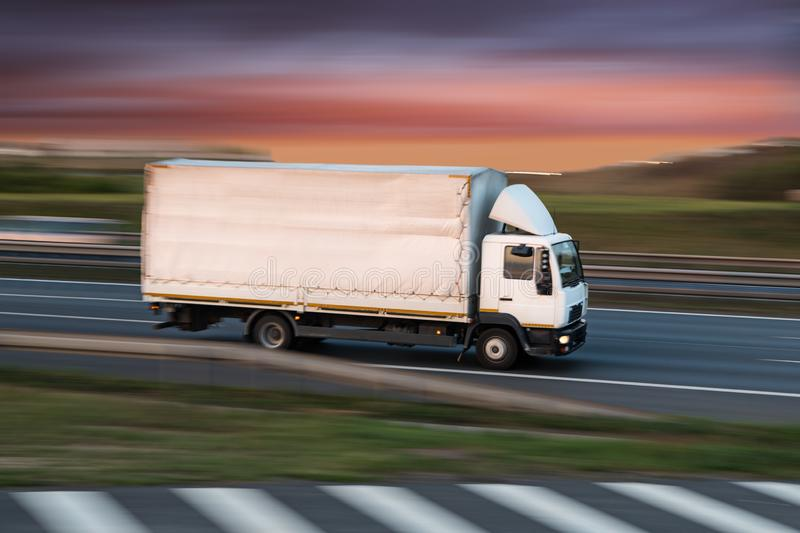 Small Truck on road, cargo transportation concept. royalty free stock photography