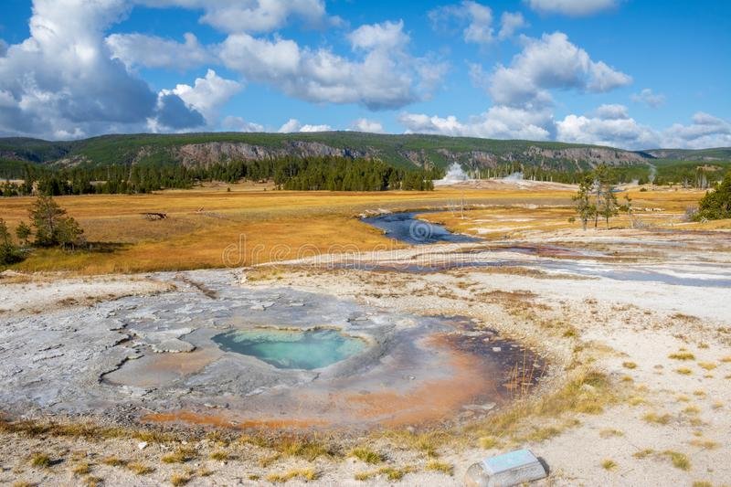 Small turquoise hot spring in the Upper Geyser Basin. Small turquoise hot spring near the Firehole River in the Upper Geyser Basin area of Yellowstone National stock image