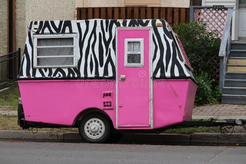 Small uniquely patterned and bright pink trailer royalty free stock image