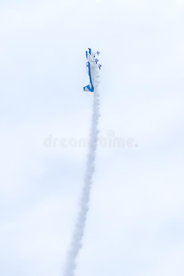 Small US Air Force Plane Flying Straight Up At 90 Degrees While Performing At An Air Show royalty free stock image
