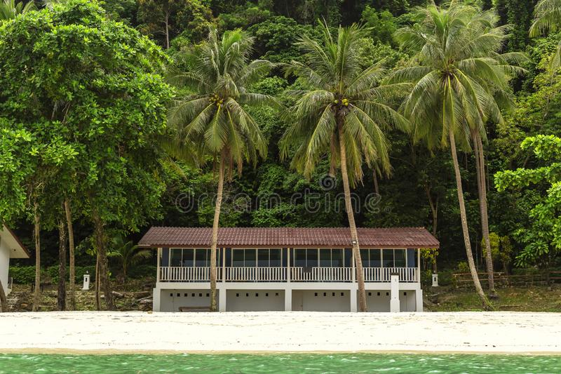 A small villa on the island, and a backdrop of a small forest. royalty free stock photography