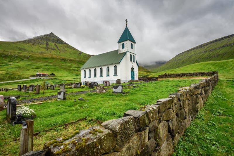 Small village church with cemetery in Gjogv, Faroe Islands, Denmark royalty free stock photo
