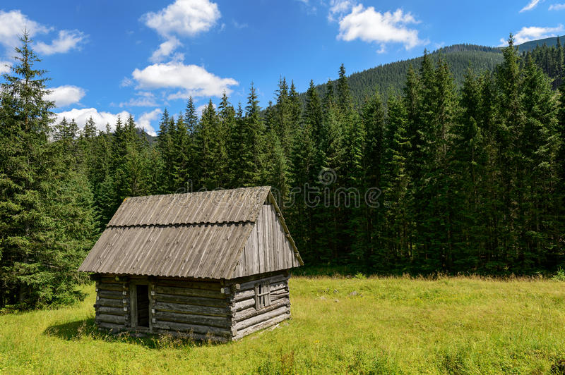 Small village cottage in the mountain valley. stock images