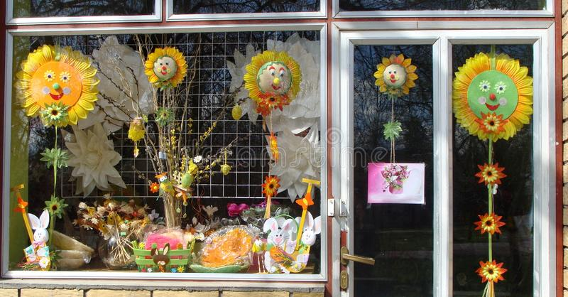 Cheerfull window of shop in small village in Vojvodina, Serbia.  Joy. Smiling faces. Handicrafts. Sunflowers. royalty free stock photography