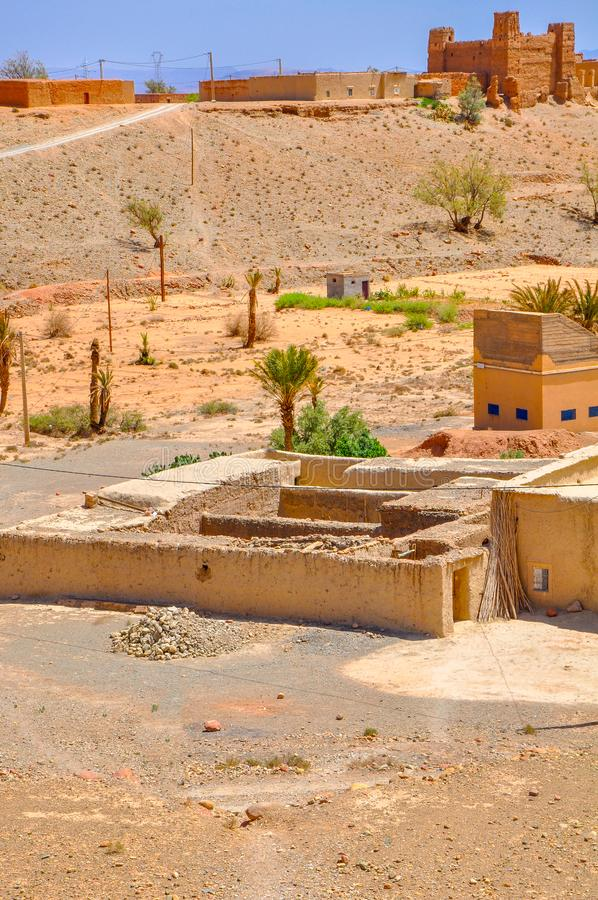 Small village in a desert part of Morocco. Mud houses of bright saturated color stock photo