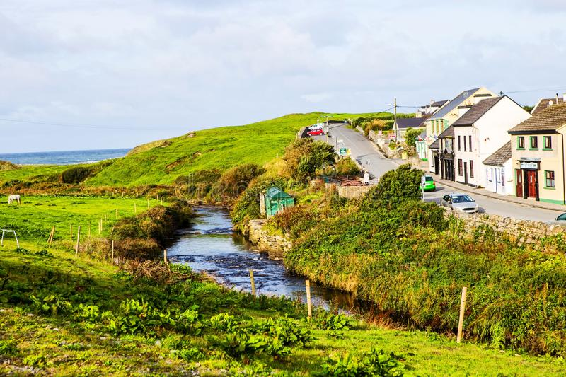 Small village of Doolin main street, Ireland. Small village of Doolin main street with creek, Cliffs of Moher, Ireland royalty free stock images