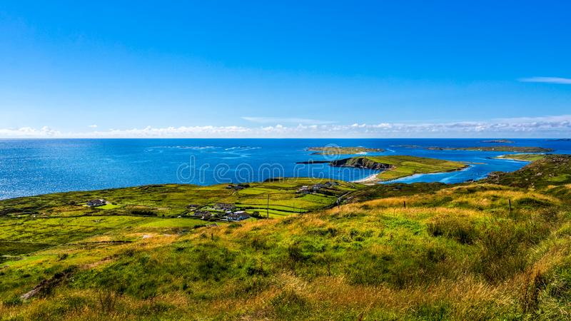 Small village, green fields and meadows on the coast, Wiled Atlantic Way, Ireland royalty free stock image
