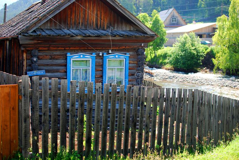 Small village house with a fence. Beautiful small village house with a fence, Altay, Russia stock image
