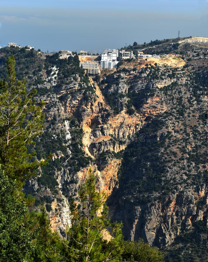 Small village in Mount Lebanon, construction at the edge of a cliff with sign of erosion. Lebanon and dramatic mountains mountains landscape ,mount Lebanon stock photos