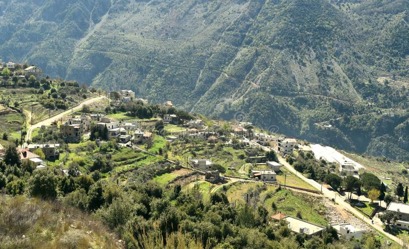 Small village in Mount Lebanon, terrace culture  around the village Mechen, lebanon  and dramatic mountains stock images