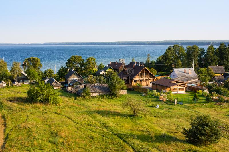 Small village Nanosy on shore of lake Naroch, Belarus. Small village Nanosy and lake Naroch, Belarus stock photo