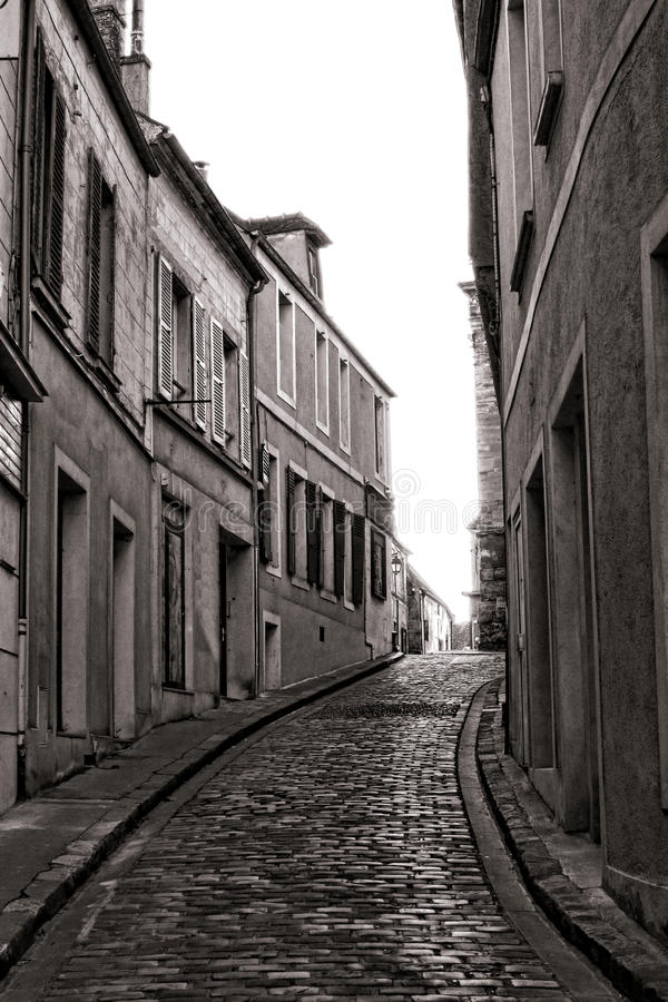 Small Village Narrow Cobblestone Street in France stock photography