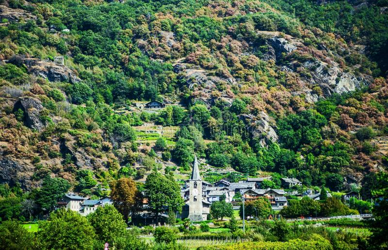 Small village in the Italian Alps. Small village nestled among trees in the Italian Alps, Italy royalty free stock photos