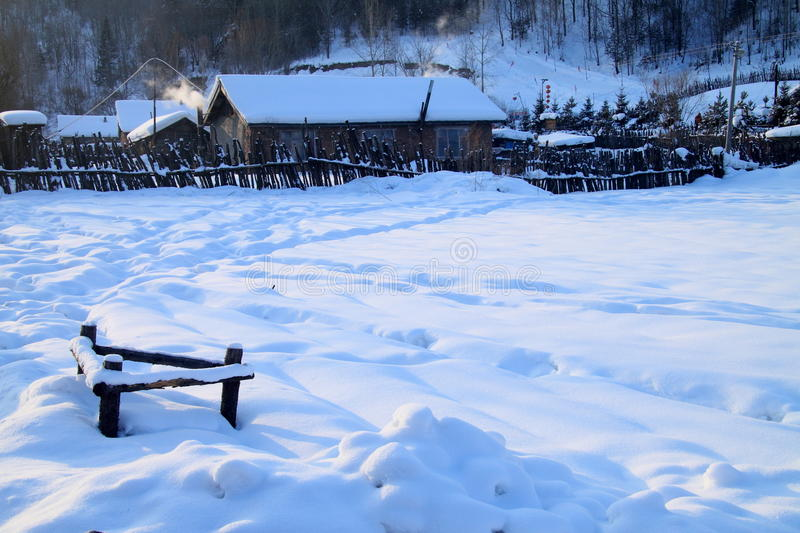 Small village in north China. A beautiful small village in north China. The ground is covered by heavy snow. Heavy snow indicates a good harvest next year royalty free stock image