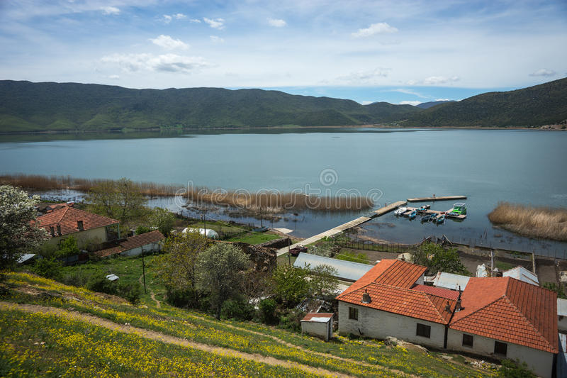 Small village on slope of hill at Prespa lake royalty free stock photo