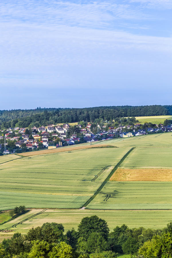 Small village in the Taununs with fields. Under blue sky stock photo