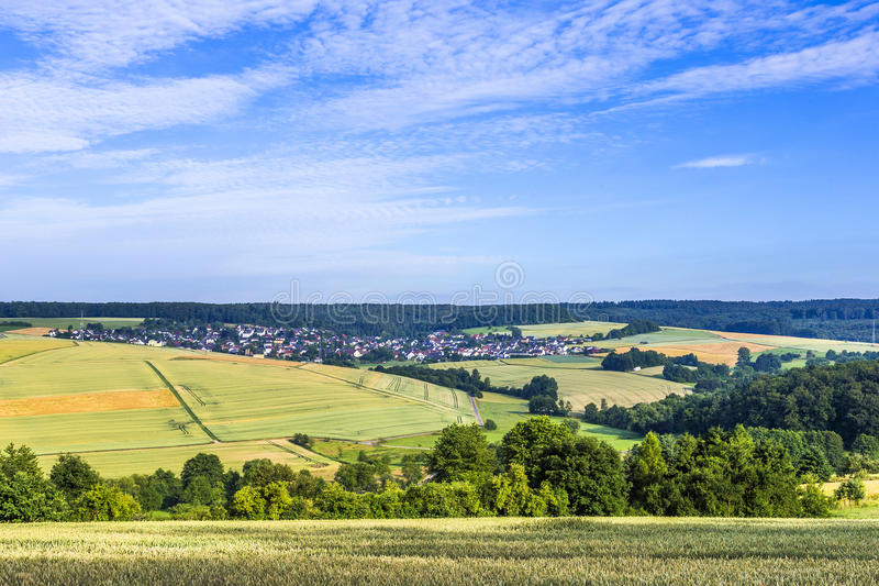 Small village in the Taununs with fields. Under blue sky royalty free stock photo