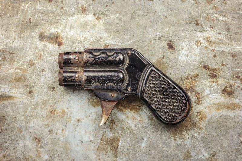 Small vintage double barrel handgun stock image