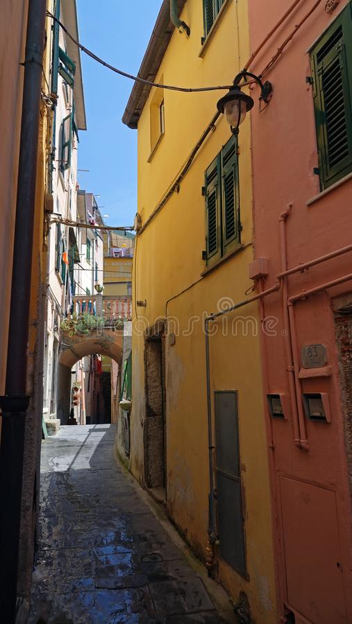 Riomaggiore small street in Cinque Terre, Italy. Small walking street in village of Riomaggiore. The Cinque Terre five towns is a string of five fishing villages stock photography