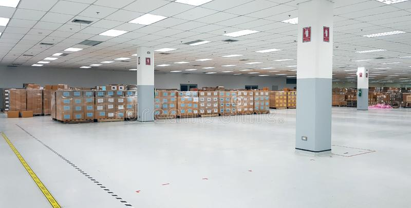 Small warehouse logistic or distribution center in electronic industry. Interior of warehouse with rows of shelves with big boxes.  royalty free stock image