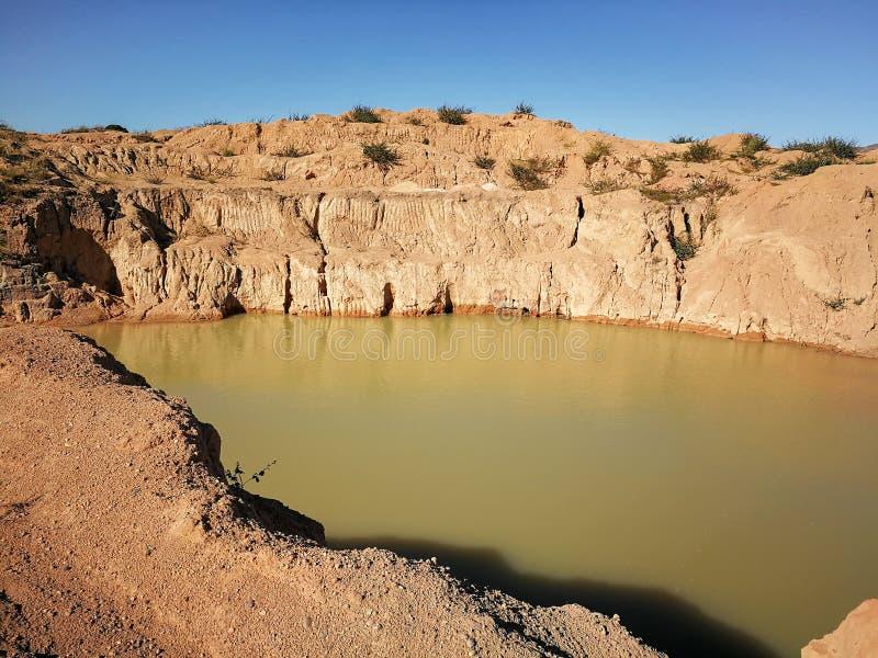 Small water lake at semi precious gems mostly sapphire mine at Ilakaka, Madagascar stock image