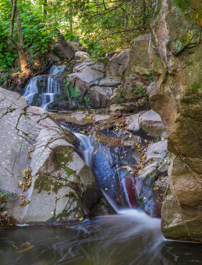 Free Small Waterfall Between Rocks In Autumn Stock Images - 161341344