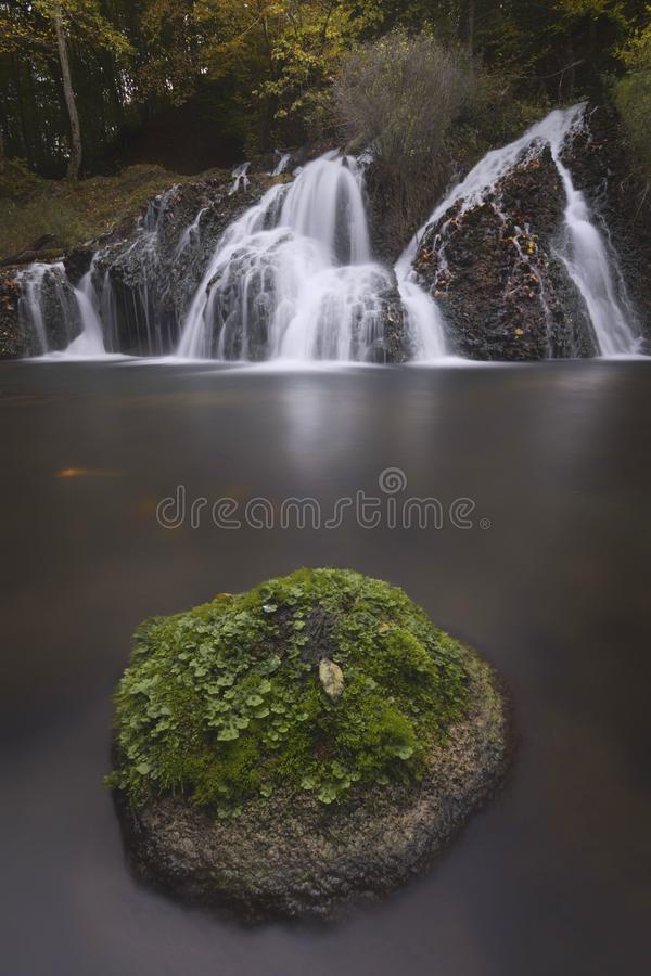 The small waterfall in bulgarian forest stock photography