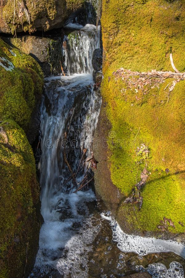 Small waterfall at a creek with rocks royalty free stock image