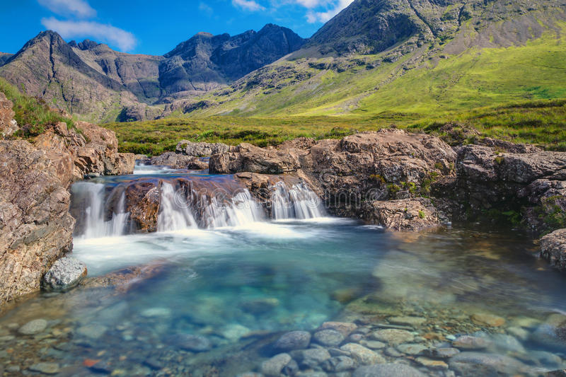 Small waterfall on the Isle of Skye. A small waterfall at the fairy pools on the Isle of Skye, Scotland stock photography